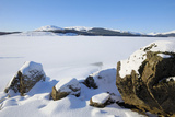 Clatteringshaws Loch  Frozen and Covered in Winter Snow  Dumfries and Galloway  Scotland  UK