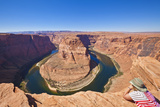 Tourist Overlooking Horseshoe Bend on the Colorado River  Page  Arizona  United States of America