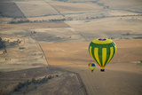 Two Hot Air Balloons Floating over Brown Countryside Near Northam in Western Australia  Australia