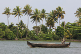 Fisherman in Traditional Boat on the Kerala Backwaters  Kerala  India  Asia