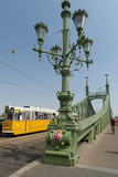Tram and Cyclist on Independence Bridge Spanning Danube River  Budapest  Hungary  Europe
