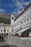 Street with Cafes  Foot Worn Polished Pavement and Clock Tower  Dubrovnik  UNESCO Site  Croatia