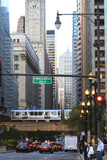 L Train on Elevated Track Crosses South Lasalle Street in the Loop District  Chicago  Illinois  USA