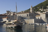 Tourist Boat in Old Harbour with Bell Tower of Monastery  Old Town  Dubrovnik  UNESCO Site  Croatia