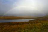 Stormy Sky and Rainbow over a Loch  Highlands  Scotland  United Kingdom  Europe