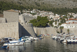Boats Moored in the Shelter of the Walls of the Old City  Dubrovnik  UNESCO Site  Croatia