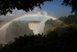 A Rainbow Arches over Victoria Falls