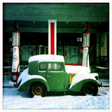 Old Car in Front of Old Timey General Store and Gas Station in Winter