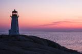 Peggy's Point Lighthouse and Rocky Coast at Dusk
