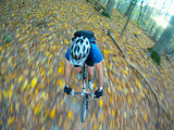 A Mountain Biker Flies Through the Woods on a Single Track Trail