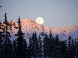 Moonrise over the North Cascades at Sunset  as Seen from Mount Baker  Washington