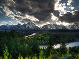 The Snake River with the Sun Setting over the Grand Tetons in the Background