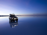 A 4X4 Rests in the Early Am Reflection in a Flooded Salt Flat In