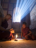 Two Novice Monks Reading Buddhist Texts Inside a Pagoda at Bagan in the Country of Burma (Myanmar)