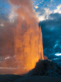 Yelowstone  Wy: White Dome Geyser Erupting with the Sun Setting Behind It