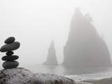 A Small Stone Cairn on Driftwood with Sea Stacks at Rialto Beach  Olympic National Park  Washington