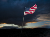 American Flag Blowing in Wind at Dusk in the Desert