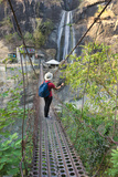Tourist on Suspension Bridge with Waterfall  Baguio  Benguet Province  Philippines