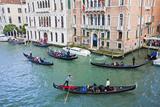 Gondolas with Riders Dressed in Carnival Attire  Venice  Italy