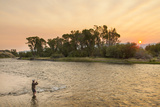 Reid Sabin Fly Fishing at Sunrise on the Madison River Near Ennis  Montana  USA