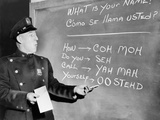 NYC Police Officer Practices Basic Spanish Phrases Written on Blackboard  Ca 1955