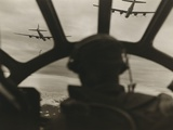 Two B-29 Super-Fortresses Drop Bombs over Malaya as Seen from the Cockpit of Third Bomber  1943-45