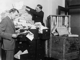 Two Employees of the Federal Radio Commission Overwhelmed by Piles of Mail in 1929