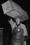 Paris Porter Wearing a Special Hard-Crowned Hat to Carry a Fish Crate  1946