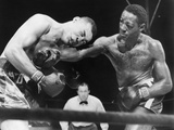 Joe Louis (Left)  and Ezzard Charles  in a Heavyweight Title Bout  Sept 27  1950