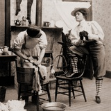 Woman Smoking and Wearing Knickers as a Man Drudges over Laundry  1901