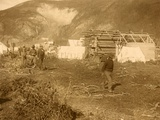 Men on Dawson City's 'Riverside Drive ' with Log and Canvas Dwellings in 1897
