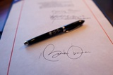 President Obama's Signature on a Bill and a Pen Used For the Signing  Feb 17  2009