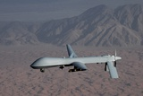 The Predator Drone Carrying Hellfire Missiles in Flight  Dec 16  2008