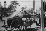 A US Army Tank Shares the Streets of Saigon  Vietnam  with Ox Carts in 1969