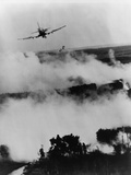 Bombs Fall from Vietnamese Air Force Skyraider over a Burning Viet Cong Base  1967