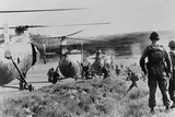 South Vietnamese Troops Run to Board Helicopters as American Advisors Watch  1962