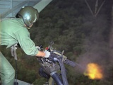US Air Force Door Gunner Fires a Mini-Gun During a Rescue Patrol  Oct 1968