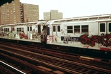 A Graffiti Painted Subway Train with Housing Projects in the Background  May 1973