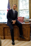 President Barack Obama Sits on the Edge of the Resolute Desk in the Oval Office  April 30  2010