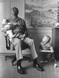 President Lyndon Johnson Sings with Dog Yuki While His Grandson Looks On  1968