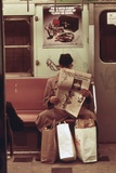 NYC Subway Passenger Reading Newspaper with Shopping Bags in May 1973