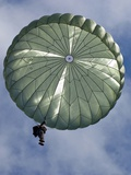 Soldier of the 82nd Airborne Descends from a Parachute Drop Over  2010