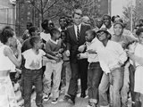 Attorney General Robert Kennedy Surrounded by African American Children  Aug 1963