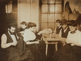 Garment Workers Sewing by Hand in a Small New York City Sweatshop In1908
