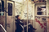 A Lone Passenger Amidst a Graffiti Painted Subway Car Interior  May 1973