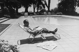 Richard Nixon Reading Newspapers While Sitting by the Pool in San Clemente  Ca 1969-74