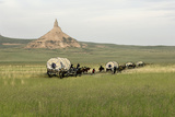 Covered Wagons Passing Chimney Rock  a Landmark on the Oregon Trail  Nebraska