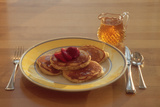 Pancakes and Strawberries with Homemade Maple Syrup for Breakfast