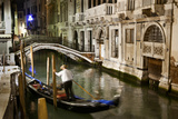 A Gondolier in a Quiet Canal At Night in Venice  Italy