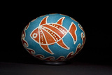 An Easter Egg with a Fish and Waves Motif
